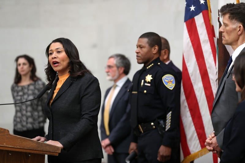 San Francisco Mayor London Breed (L) speaks during a press conference as San Francisco police chief William Scott (R) looks on at San Francisco City Hall on March 16, 2020 in San Francisco, California.