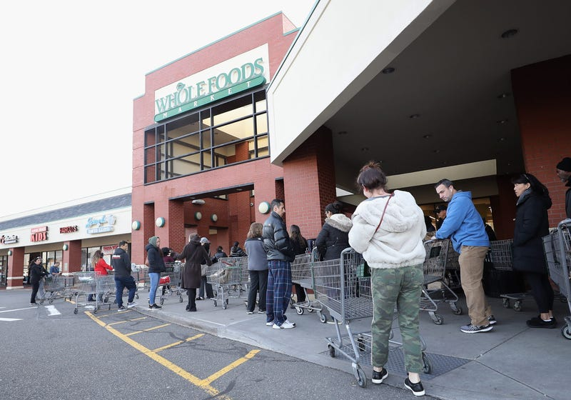 Customers wait for the opening of Whole Foods on March 18, 2020 in Jericho, New York.