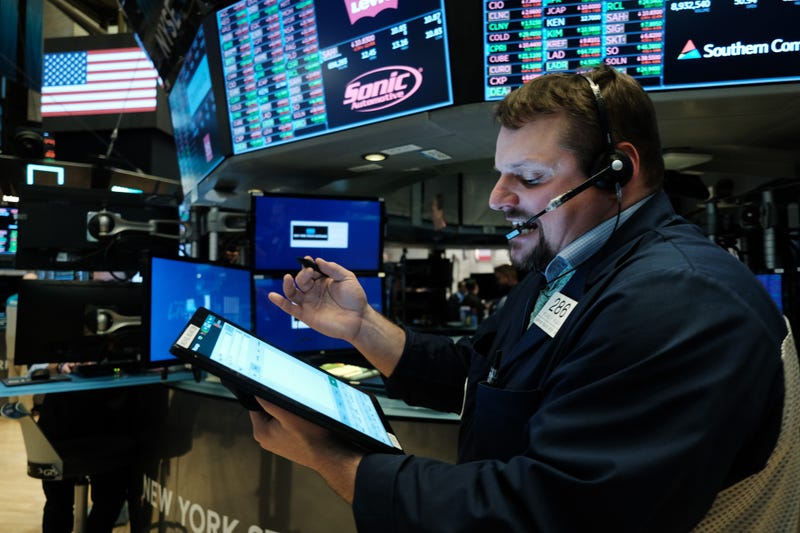 Traders work on the floor of the New York Stock Exchange (NYSE) on March 20, 2020 in New York City.