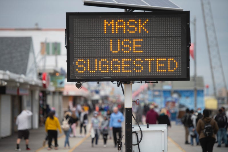 """A sign placed on the boardwalk states """"MASK USE SUGGESTED"""" on May 24, 2020 in Wildwood, New Jersey."""