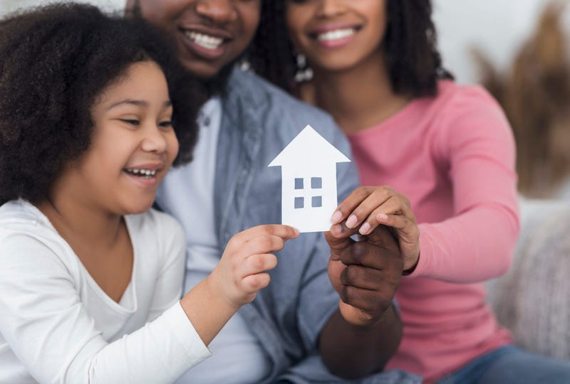 Stay At Home And Family Housing Concept. Cutout Paper House In Hands Of Little Girl Her Parents,