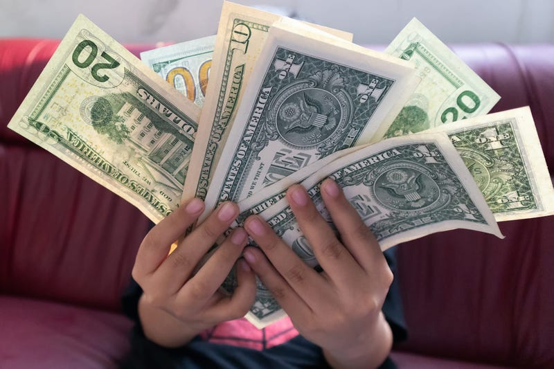 Dollar money banknote in young boy hand.Freelance Business making money and Internet shopping online concept