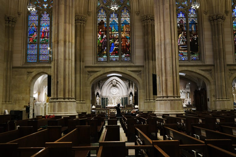 Church pews stand empty as Cardinal Timothy Dolan, the Archbishop of New York, celebrates Easter Sunday Mass in a nearly empty St. Patrick's Cathedral as the coronavirus outbreak has kept most churches empty this Easter on April 12, 2020 in New York City.