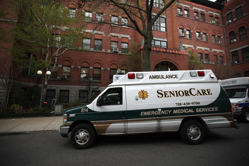 An ambulance pulls up outside of the Cobble Hill Health Center on April 18, 2020 in the Cobble Hill neighborhood of the Brooklyn borough of New York City.