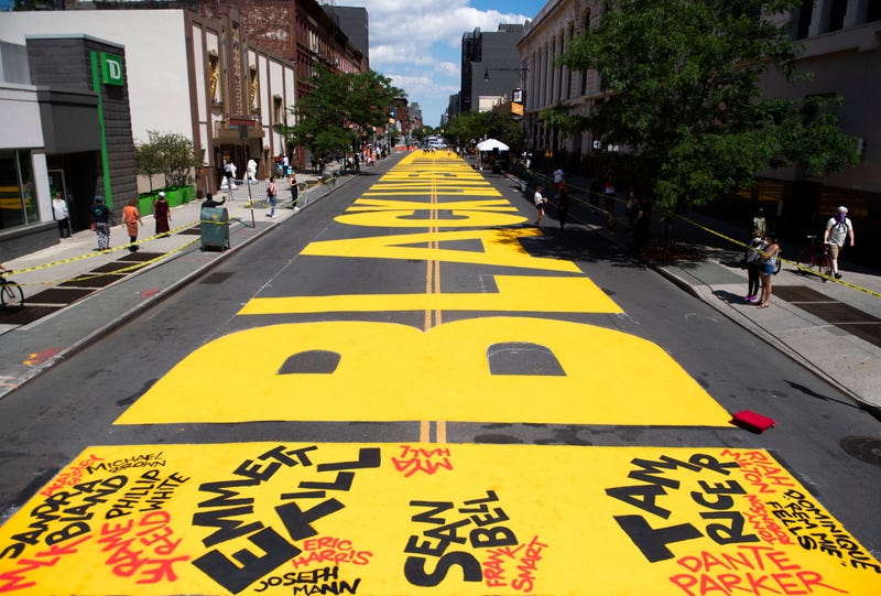 A Black Lives Matters mural covers Fulton St on June 14, 2020 in the Brooklyn borough of New York City.