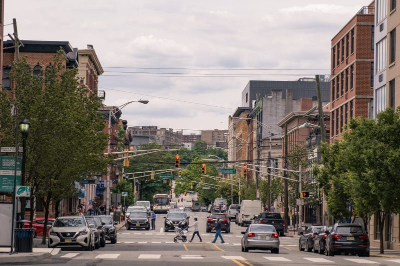 People wearing the protective mask walk on the street as the city reopens from the coronavirus lockdown on June 15, 2020 in Hoboken, New Jersey.