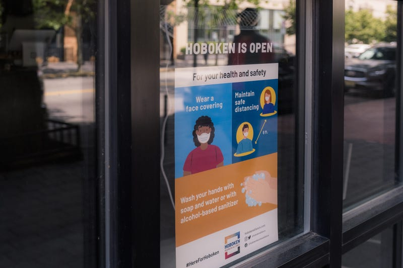A sign reading Hoboken Is Open is displayed in the window as the city reopens from the coronavirus lockdown on June 15, 2020 in Hoboken, New Jersey.
