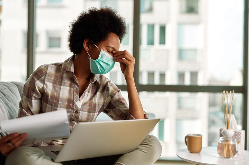 A Black woman working from home during pandemic.