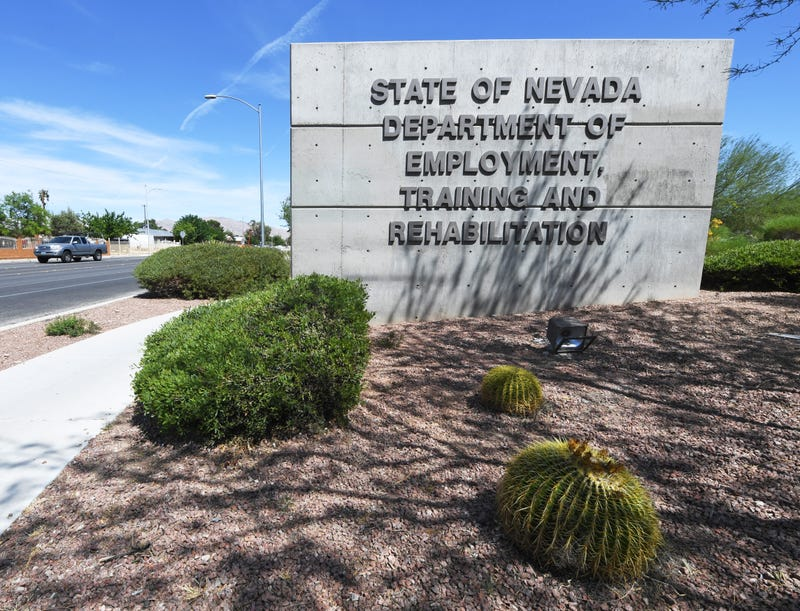 A vehicle drives by a sign at the State of Nevada Department of Employment, Training and Rehabilitation (DETR) as the coronavirus continues to spread on April 28, 2020 in Las Vegas, Nevada.