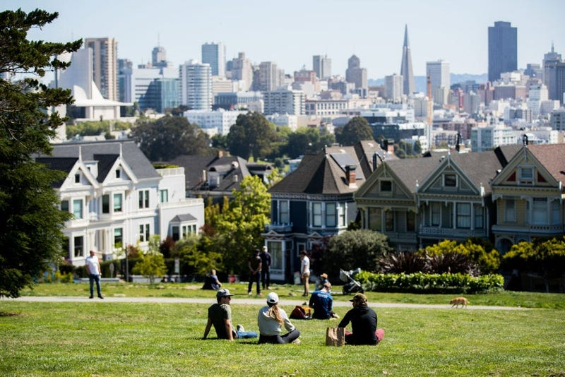 People Sit in Alamo Square Park during Shelter in Place Orders