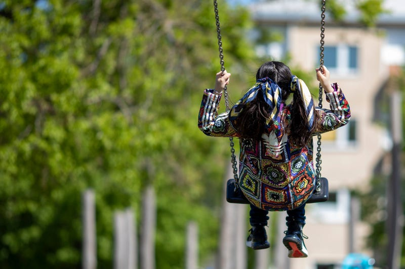 BERLIN, GERMANY - MAY 06: A girl swings at re-opened playground during the coronavirus crisis on May 06, 2020 in Berlin, Germany.
