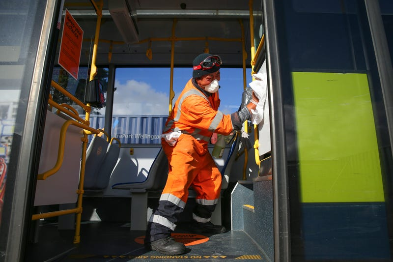 Senior Yard Supervisor Lipi Vitolio disinfects the interior surface of a bus at Tranzit Bus Depot on May 09, 2020 in Wellington, New Zealand.