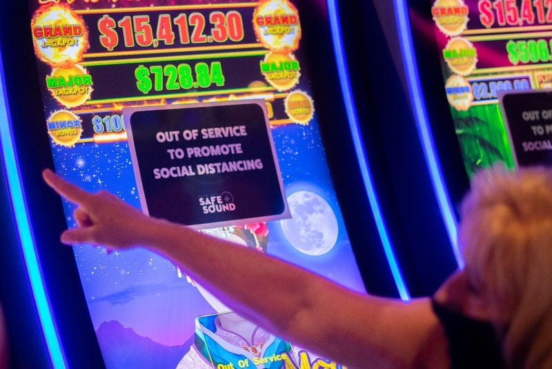 A placard is posted on a slot machine to promote social distancing at Hard Rock Casino after it reopened on July 3, 2020 in Atlantic City, New Jersey.