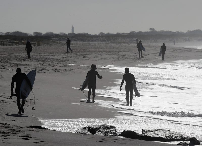 Surfers take to the water in higher than normal wave conditions on May 21, 2020 in Lido Beach, New York.