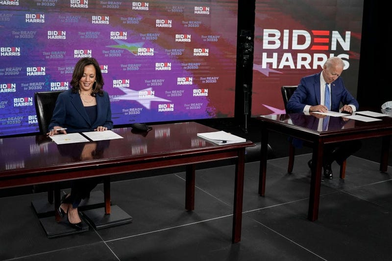 Presumptive Democratic presidential nominee former Vice President Joe Biden (R) and his running mate Sen. Kamala Harris (D-CA) sign required documents for receiving the Democratic nomination for President and Vice President