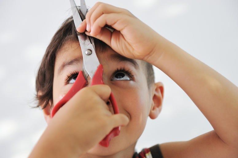 Boy Cutting His Hair