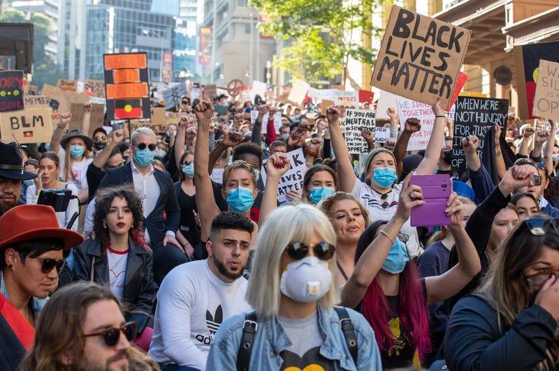 BRISBANE, AUSTRALIA - JUNE 06: People kneel in the CBD on June 06, 2020 in Brisbane, Australia.