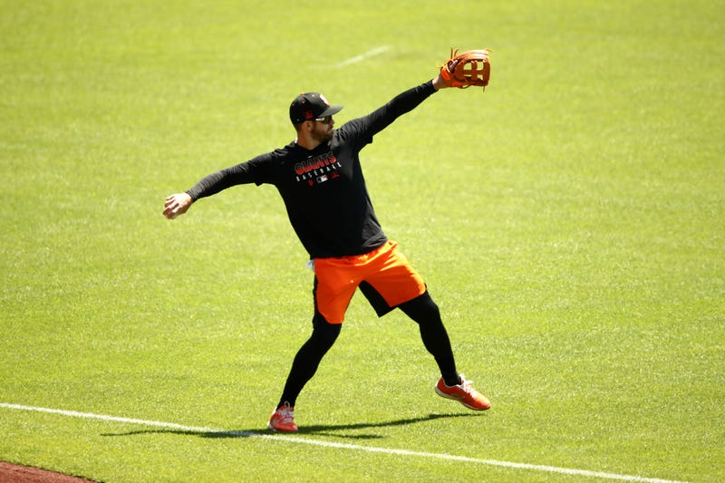 Evan Longoria #10 of the San Francisco Giants plays catch during summer workouts at Oracle Park on July 03, 2020 in San Francisco, California.