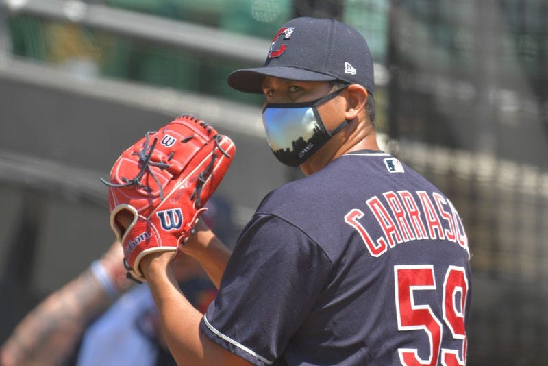 CLEVELAND, OHIO - JULY 06: Pitcher Carlos Carrasco #59 of the Cleveland Indians throws in the bullpen during summer workouts at Progressive Field on July 06, 2020 in Cleveland, Ohio. (Photo by Jason Miller/Getty Images)