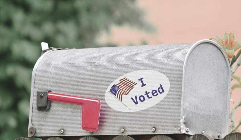 Mail box with voting sticker
