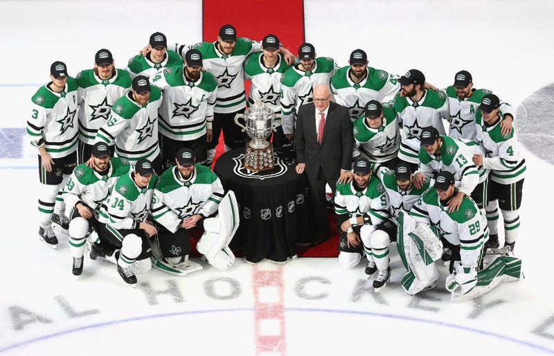 The Dallas Stars with Bill Daly, the deputy commissioner and chief legal officer of the National Hockey League (NHL) and the Clarence S. Campbell Bowl after winning the Western Conference Championship over the Vegas Golden Knights in Game 5.