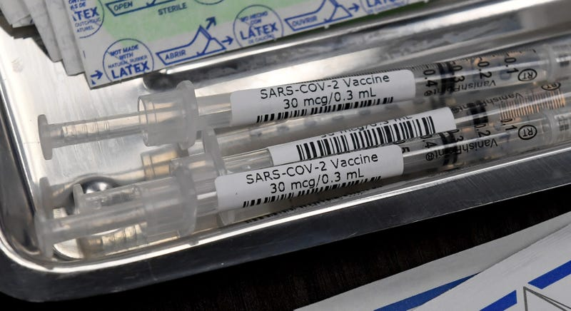 Syringes with the Pfizer-BioNTech COVID-19 vaccine are placed in a tray on a table as vaccinations are given out at University Medical Center of Southern Nevada on December 16, 2020, in Las Vegas, Nevada.