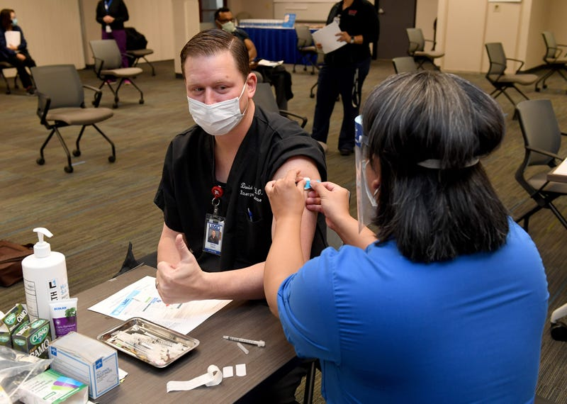 Dr. David Obert gives a thumbs-up after receiving a Pfizer-BioNTech COVID-19 vaccination at University Medical Center of Southern Nevada on December 16, 2020, in Las Vegas, Nevada.