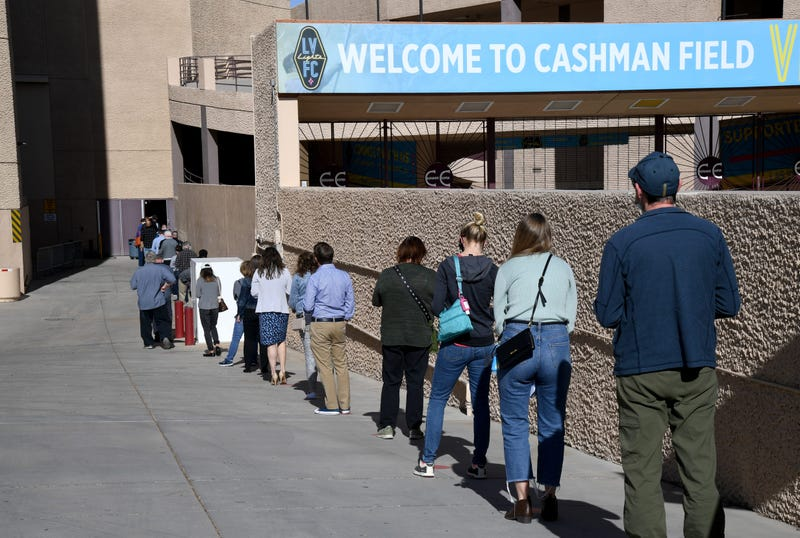 People line up on the first day of Clark County's pilot COVID-19 vaccination program at Cashman Center on January 14, 2021 in Las Vegas, Nevada.