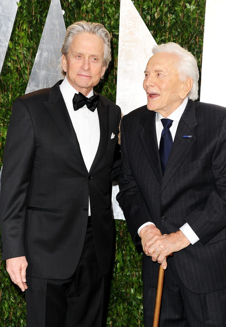 Actors Michael Douglas (L) and Kirk Douglas arrive at the 2012 Vanity Fair Oscar Party hosted by Graydon Carter at Sunset Tower on February 26, 2012 in West Hollywood, California. (Photo by Pascal Le Segretain/Getty Images)