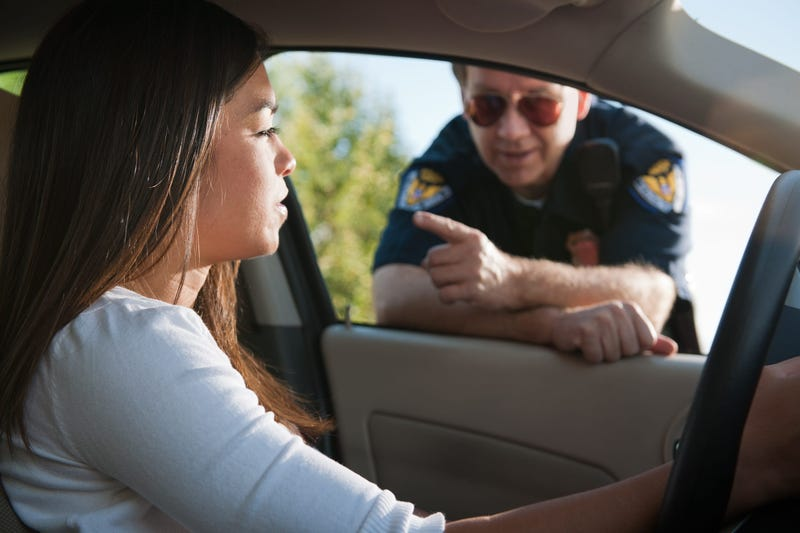 Woman getting pulled over