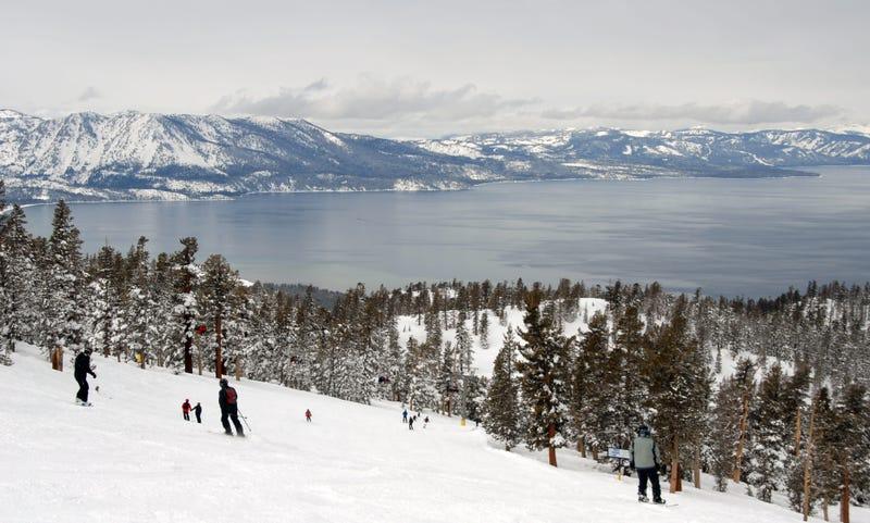Skiers and snowboarders near Lake Tahoe.