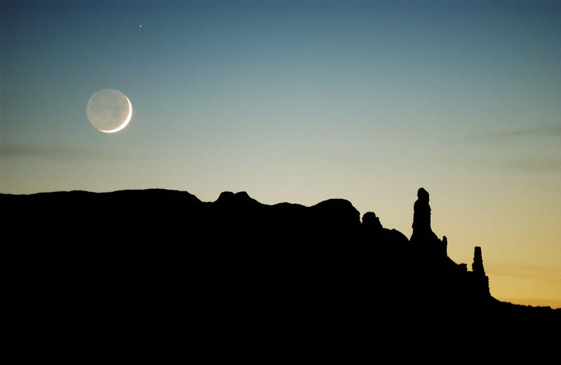 NAVAJO INDIAN RESERVATION, AZ - DECEMBER 5: The moon sets over sandstone formations near Round Rock December 5, 2002 on the Navajo Indian Reservation, Arizona.
