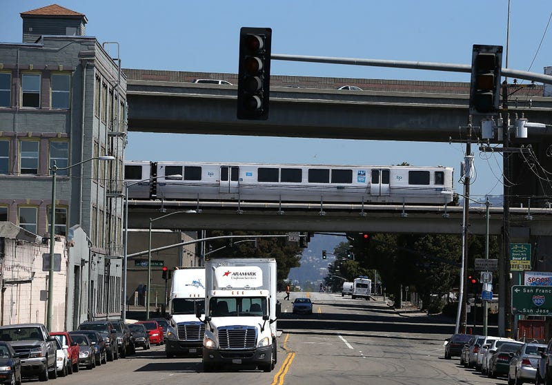 : A Bay Area Rapid Transit (BART) train travels towards downtown Oakland on August 2, 2013 in Oakland, California.