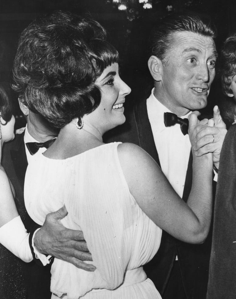 Elizabeth Taylor dancing with Kirk Douglas at the party in Rome for the film 'Spartacus'. (Photo by Keystone/Getty Images)