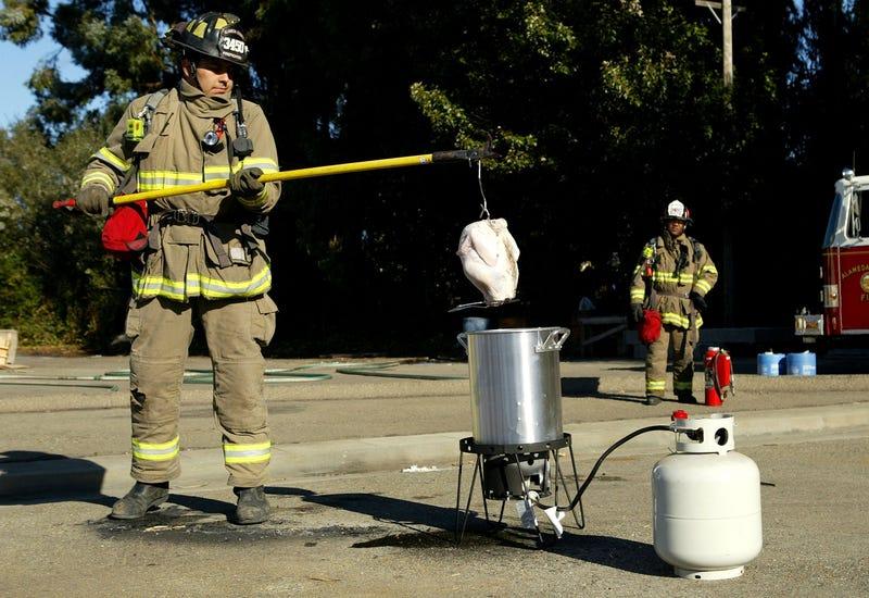 Firefighter demonstrates deep-frying turkey