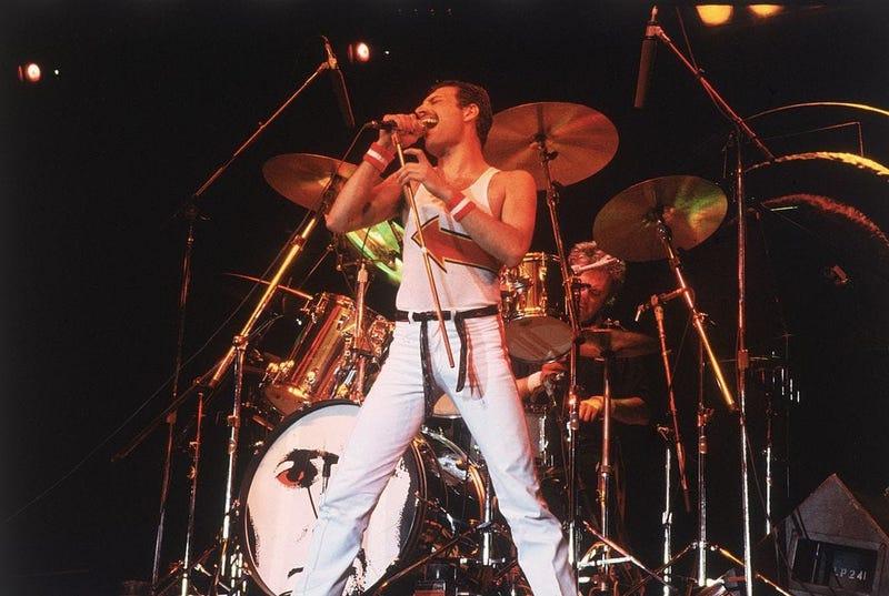 Freddie Mercury (1946 - 1991), lead singer of 70s hard rock quartet Queen, in concert in Milton Keynes.