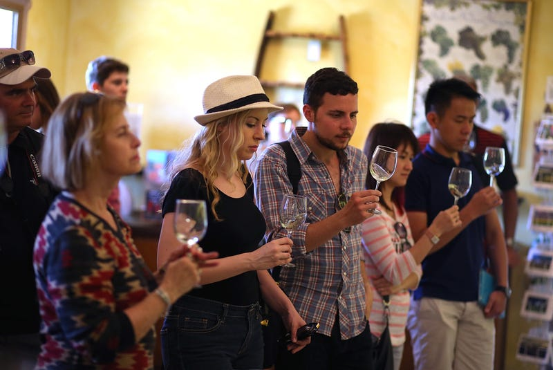 tour group tastes wine at Madonna Estate Winery on August 26, 2014 in Napa.
