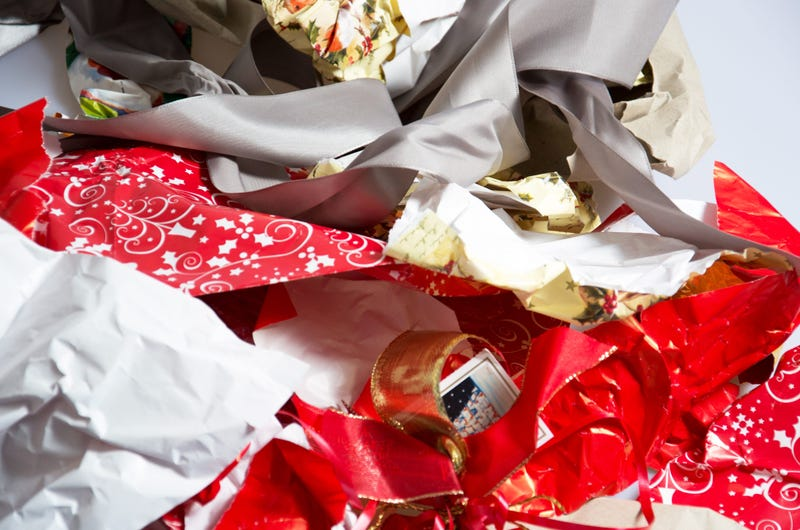 A bunch of used, torn up holiday gift wrapping paper