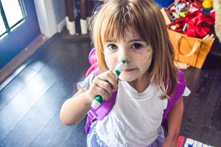 Child Drawing on Their Face