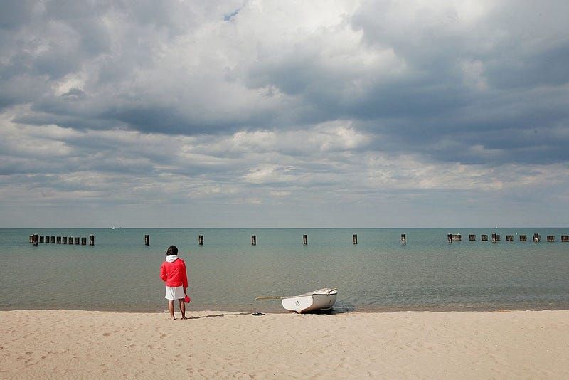 Lifeguard Ben Ingvoldscad watches over the waters of Lake Michigan at North Avenue Beach May 27, 2005 in Chicago, Illinois.