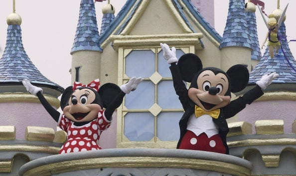 Disney characters Mickey Mouse and Minnie Mouse perform during the parade at Hong Kong Disneyland on September 11, 2005 in Hong Kong. The new theme park is scheduled to have its grand opening September 12