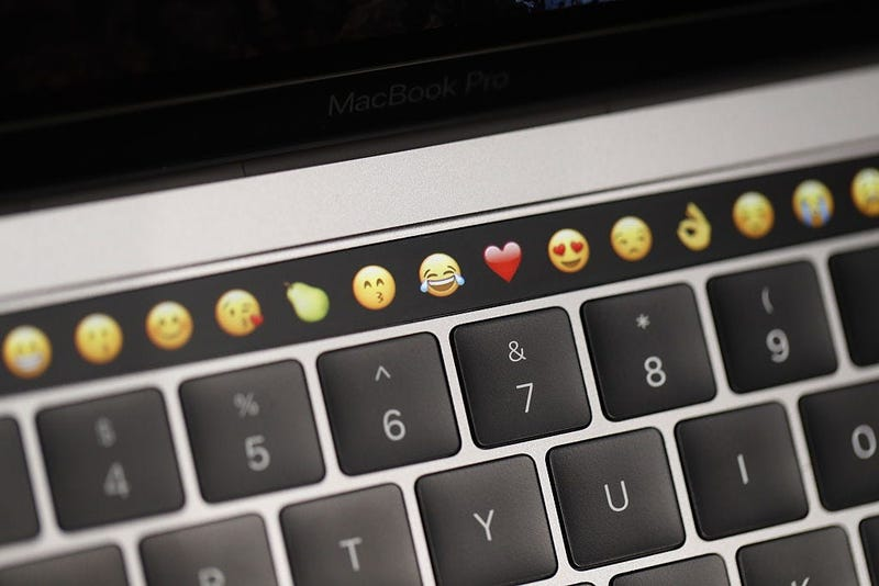 Emojis on a new Apple laptop during a product launch event