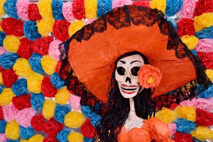 Day of the dead. Traditional Mexican Catrina skeleton against an old wall.