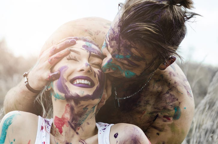 happy boyfriend and girlfriend, man kissing the girl's head