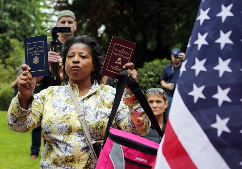 Woman holding Constitution and Declaration