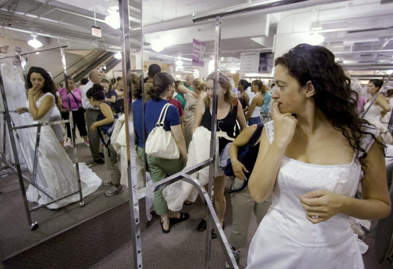 Bride-to-be Jennie Rothenberg tries on a wedding gown during Filene's Basement's annual sale, Aug. 4, 2006 in Washington, D.C.