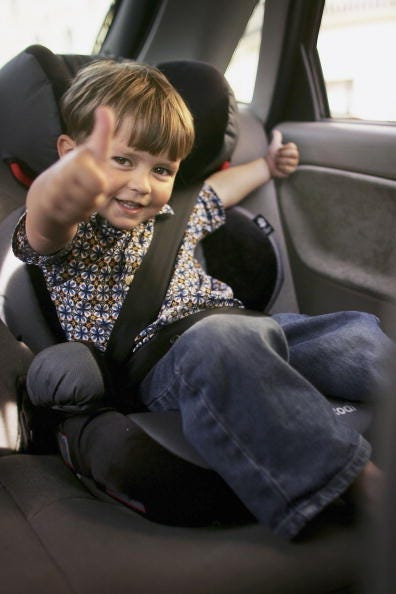 Charlie Woodhouse gestures from his new child seat