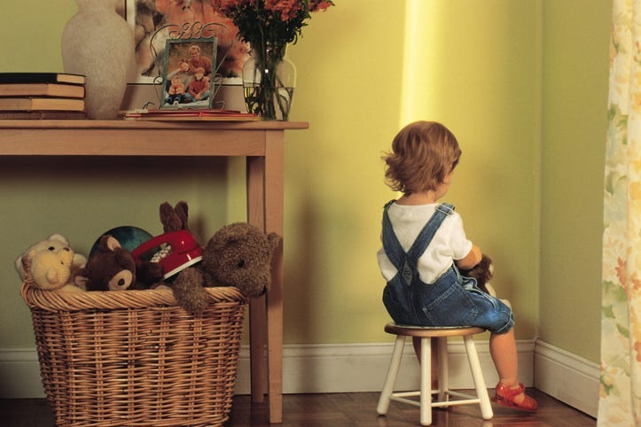 A child sitting in timeout.