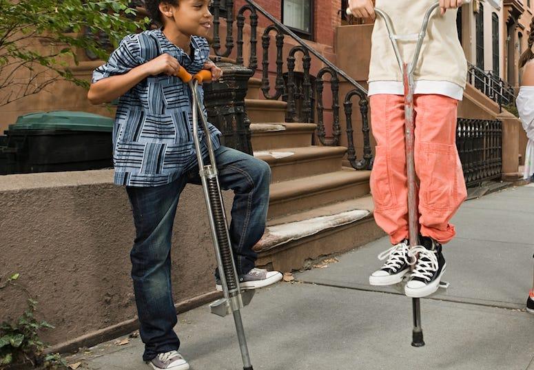 Boys, Pogo Sticks, Bouncing, Sidewalk, City, Downtown, Village