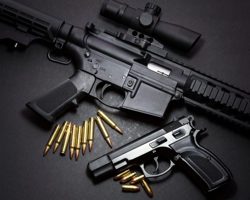 9mm handgun with ar15 rifle and ammunition